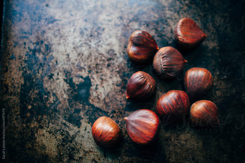 chestnuts on a roasting pan by Sarah Lalone for Stocksy United