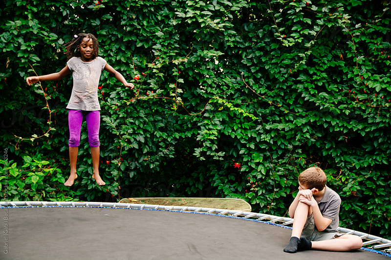 Girl on Trampoline by Gabriel (Gabi) Bucataru for Stocksy United