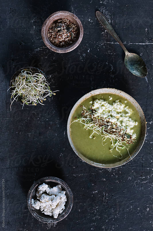 Bean soup with seeds, bean sprouts and ricotta by Alberto Bogo for Stocksy United