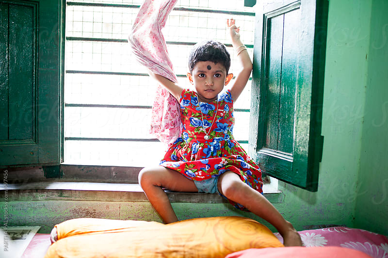 A little girl indise home by PARTHA PAL for Stocksy United