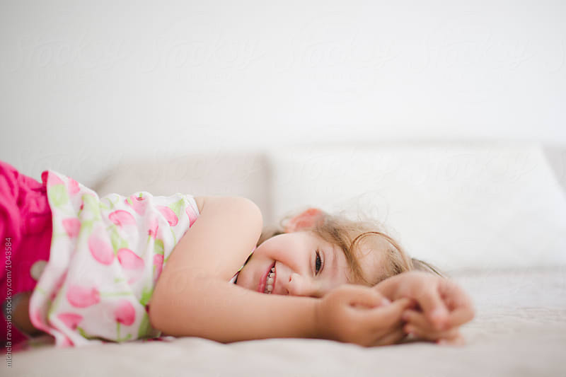 Happy cute baby girl looking at camera by michela ravasio for Stocksy United