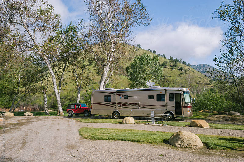 RV in a Campground by Adam Nixon for Stocksy United