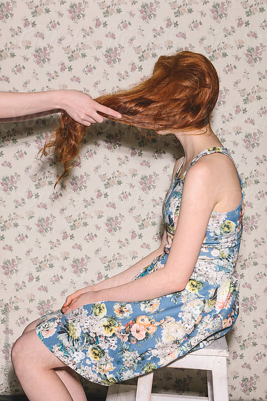Woman's hands pulling red hair of other woman by T-REX & Flower for Stocksy United