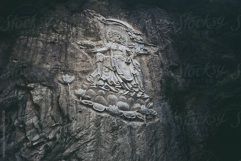 Arya Avalokiteshvara statue on the cliff  by zheng long for Stocksy United