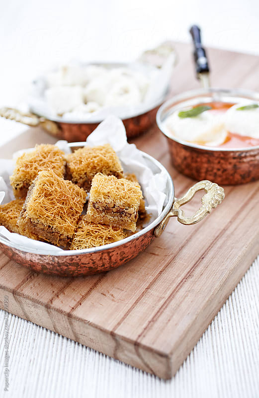 Shredded wheat in syrup with walnut - Cevizli Kadayıf by Paperclip Images for Stocksy United