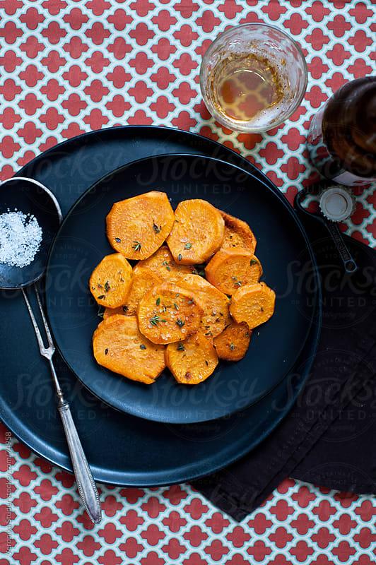 Baked sweet potato by Veronika Studer for Stocksy United