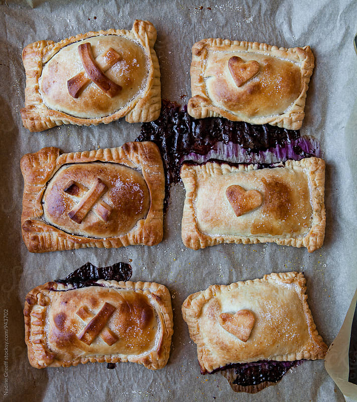 Individual blueberry pastries by Nadine Greeff for Stocksy United