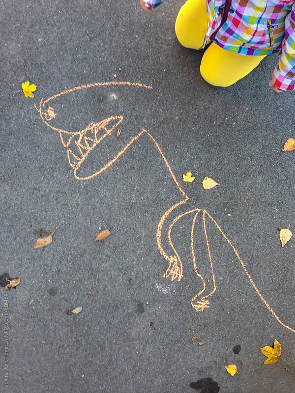 Child drawing made by chalk on a pavement by Jelena Jojic Tomic for Stocksy United