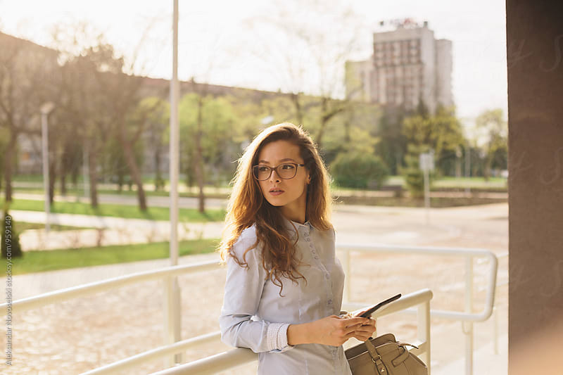 Beautiful businesswoman using her tablet by Aleksandar Novoselski for Stocksy United