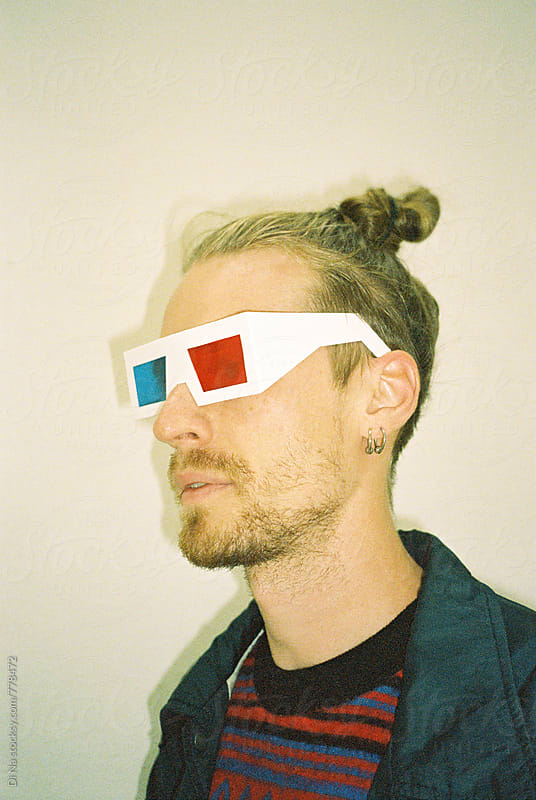 Young man in 3d glasses by Dina Lun for Stocksy United