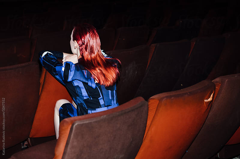 Fashion Model Sitting in the Cinema by Katarina Radovic for Stocksy United