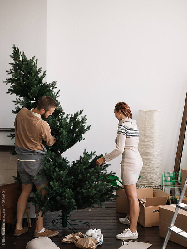 Couple Assembling Christmas Tree by Milles Studio for Stocksy United