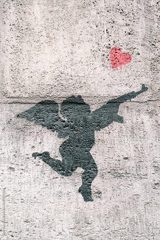 Cupid graffiti by Sam Burton for Stocksy United