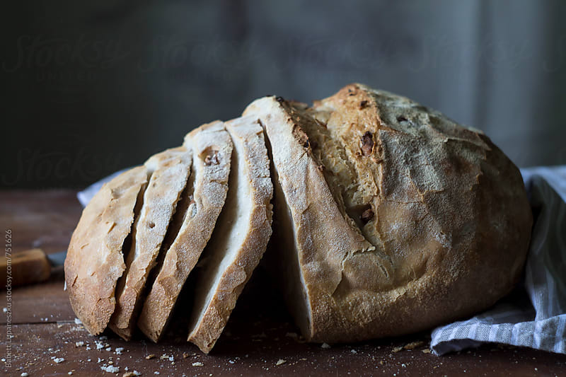Handmade walnut rye bread by Babett Lupaneszku for Stocksy United
