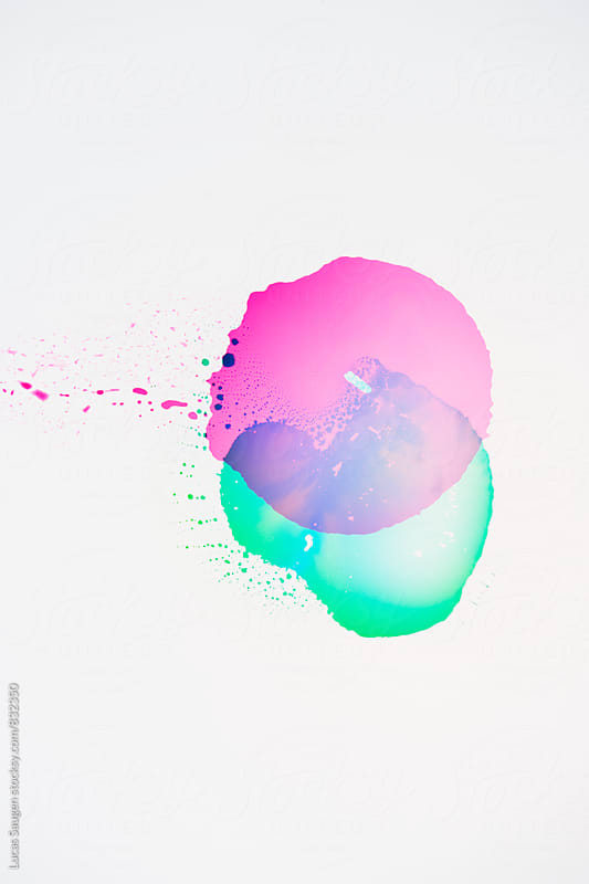 Pink and green puddles on a surface. by Lucas Saugen for Stocksy United