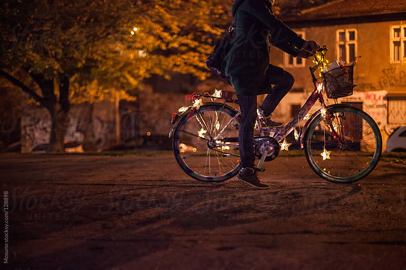 Young Woman Riding a Bicycle at Night by Mosuno for Stocksy United