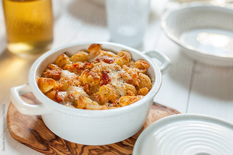 Homemade Baked Pasta with Tomato Sauce by Davide Illini for Stocksy United