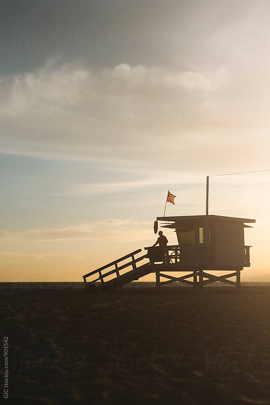 Life guard tower at sunset by Simone Becchetti for Stocksy United
