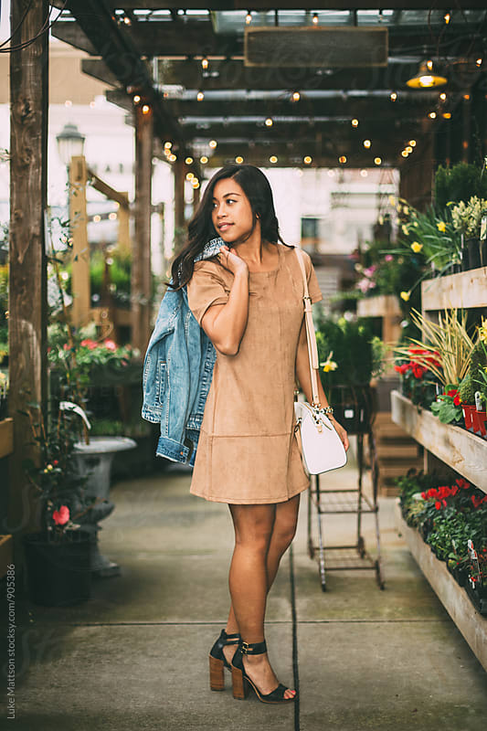 Attractive Young Woman In Tan Dress by Luke Mattson for Stocksy United