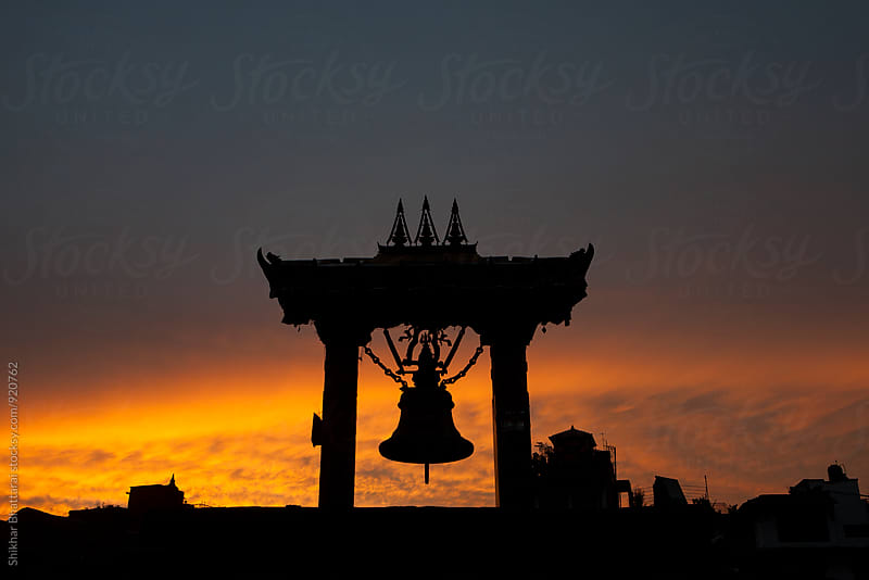 Silhouette of a large bell in Patan Durbar Square. by Shikhar Bhattarai for Stocksy United