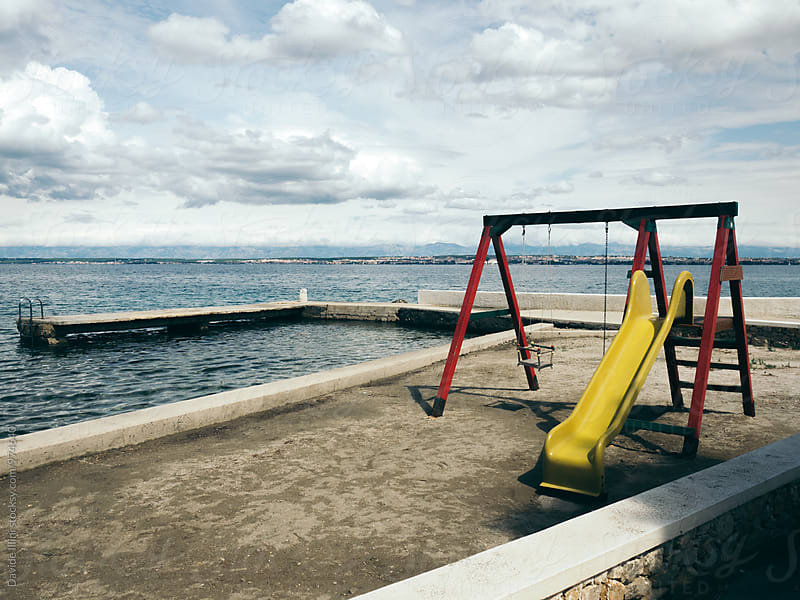 Children's playground on the beach by Davide Illini for Stocksy United