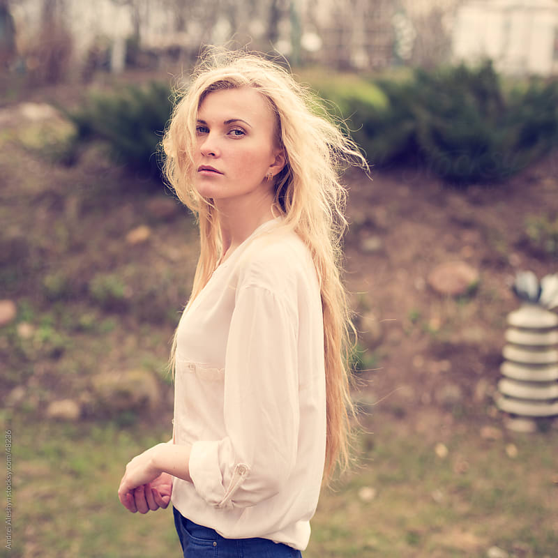 portrait of a beautiful blonde on a windy day by Andrei Aleshyn for Stocksy United