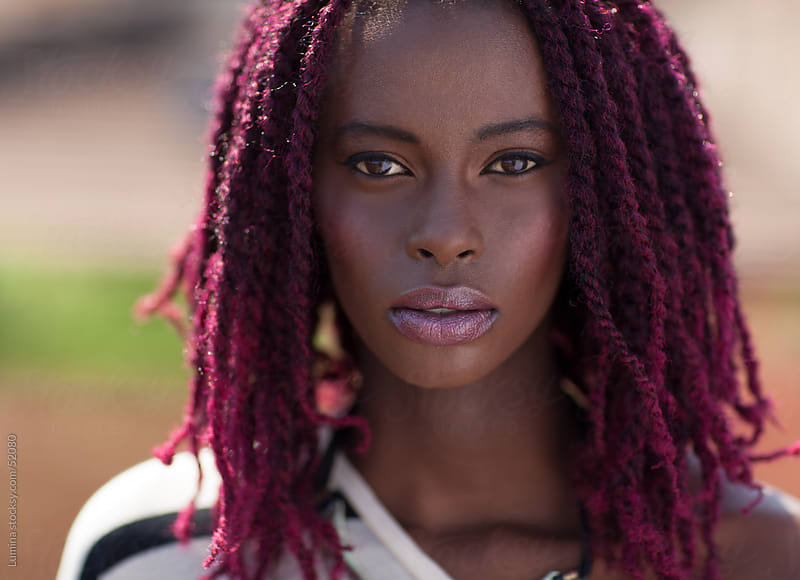 Portrait of an African Woman With Dreadlocks  by Lumina for Stocksy United