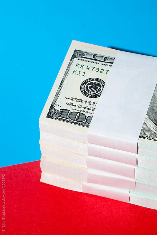 Stack of hundred dollar bills. by Shikhar Bhattarai for Stocksy United