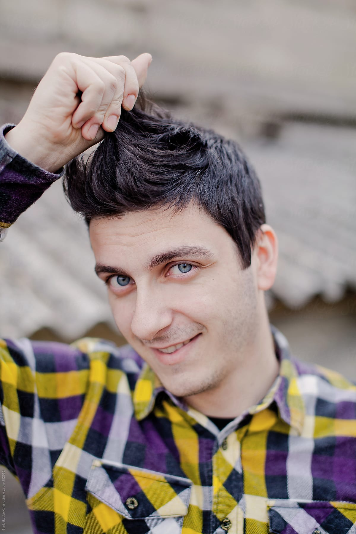 Handsome Guy With Black Hair And Big Blue Eyes And Checkerboard