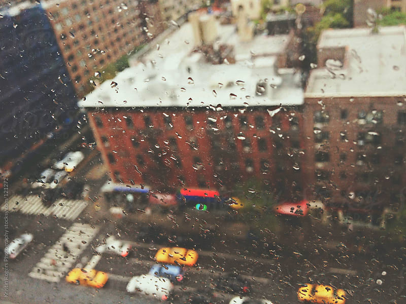 View of New York street from window in rain by Kristin Rogers Photography for Stocksy United
