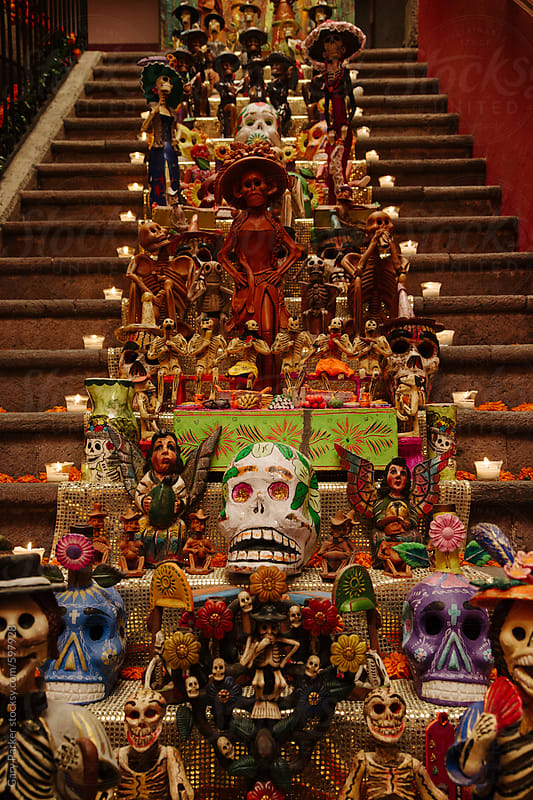 Day of the Dead decorations and candles line a staircase in Mexico City by Gary Parker for Stocksy United