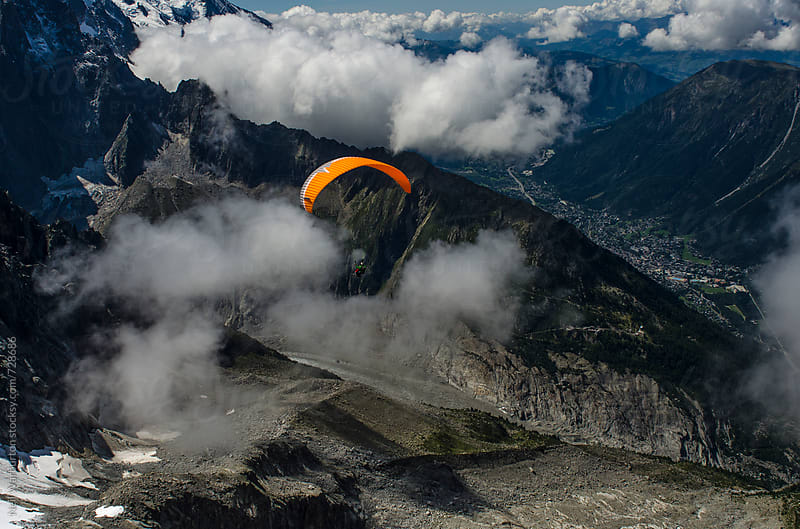Paragliding in the french alps by Neil Warburton for Stocksy United
