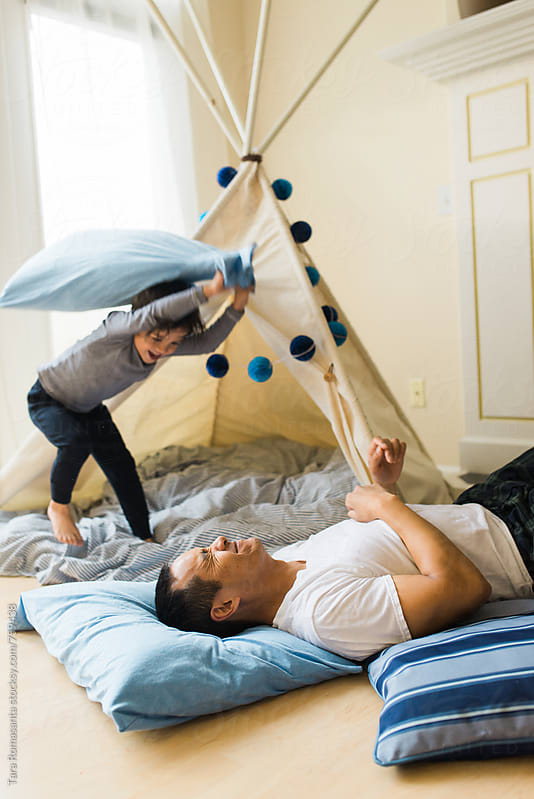 pillow fight, father and son by Tara Romasanta for Stocksy United