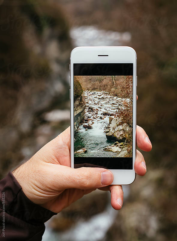taking a picture with a smartphone while hiking by Juri Pozzi for Stocksy United