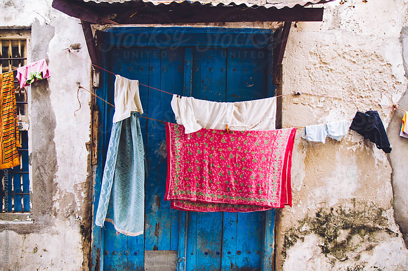 Wash day in Stone Town by Helen Rushbrook for Stocksy United