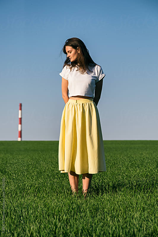 Portrait of girl in yellow skirt with long hair and eyes closed  by Danil Nevsky for Stocksy United