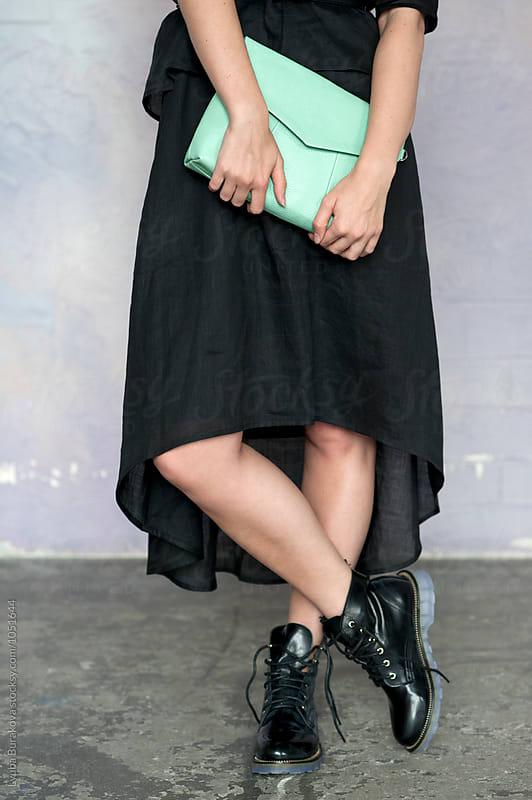 Fashion shot of a woman holding a clutch by Lyuba Burakova for Stocksy United