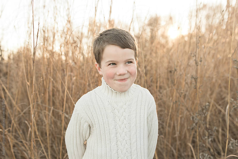 Young Boy Makes Silly Face At Camera by Alison Winterroth for Stocksy United