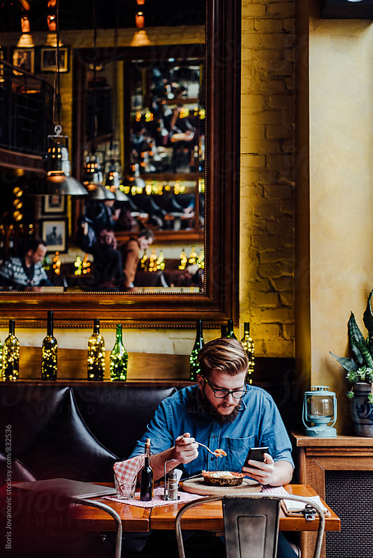 Stylish man having a lunch in the restaurant by Boris Jovanovic for Stocksy United