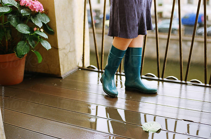 Woman wearing rubber boots by Lyuba Burakova for Stocksy United