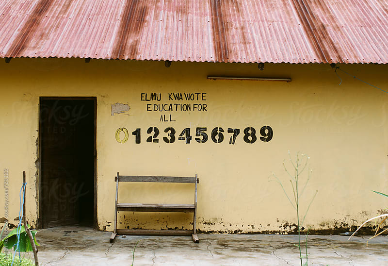 External wall of an African school with the slogan Education for All. by Helen Rushbrook for Stocksy United