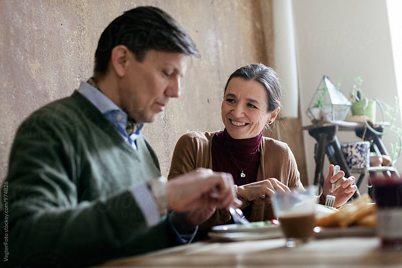 Mature Couple eating Breakfast by VegterFoto for Stocksy United