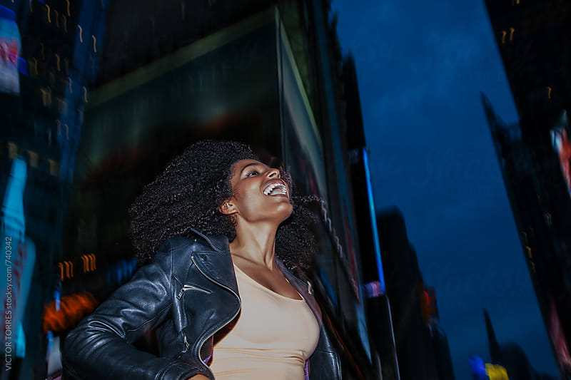 Cheerful Latin American Afro Woman in the Street by VICTOR TORRES for Stocksy United