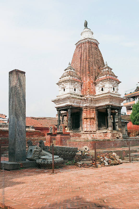 Traces of earthquake in Nepal. Damaged temple at Patan Durbar Square. by Shikhar Bhattarai for Stocksy United