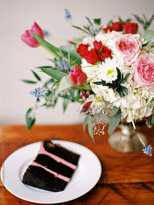 piece of cake and flowers by Kirill Bordon photography for Stocksy United