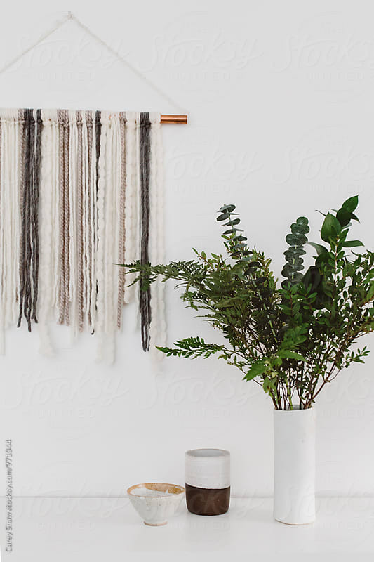 Modern pottery, DIY wall hanging and vase of greenery by Carey Shaw for Stocksy United
