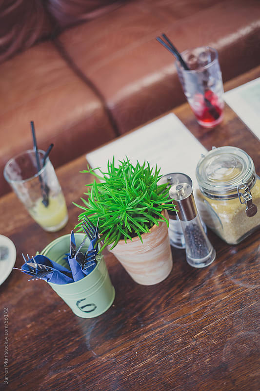 Drinks on a bar table. by Darren Muir for Stocksy United