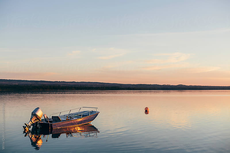 Boat and Buoy Reflection at Sunset by Willie Dalton for Stocksy United