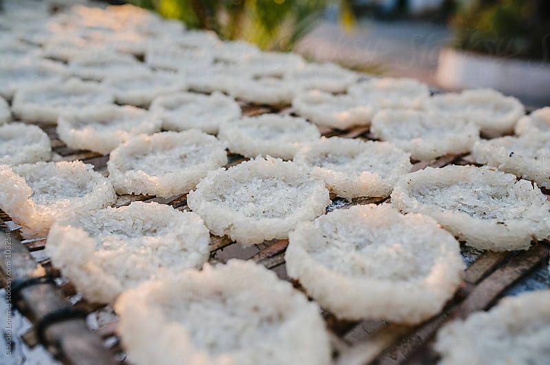 Drying rice cakes in a Buddhist Temple, Luang Prabang, Laos, Indochina, Southeast Asia, Asia by Claudia Lommel for Stocksy United