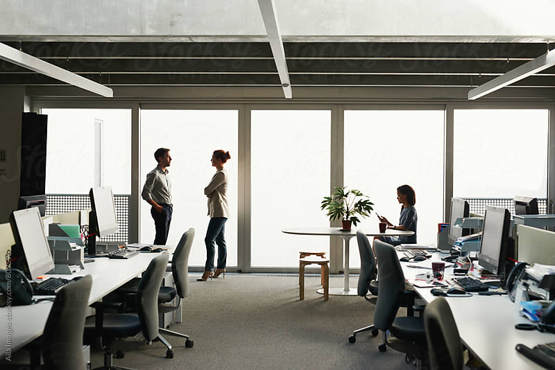 Profile silhouette of business team close to windows by Aila Images for Stocksy United